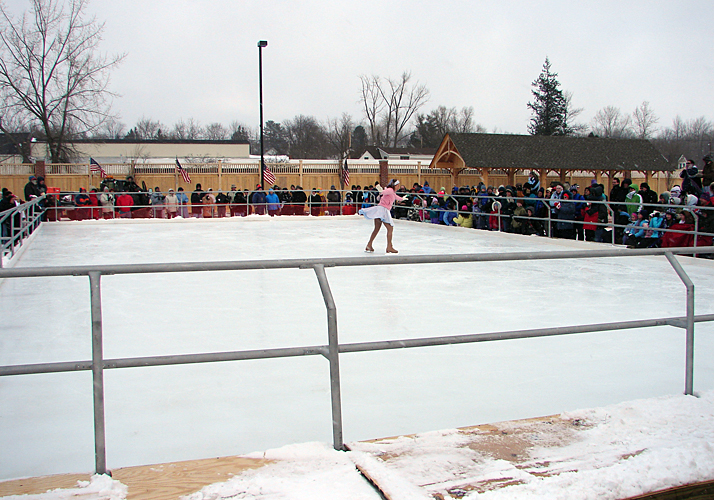 40' x 80' Portable rink with two (2) RinkMate chillers and aluminum rail system