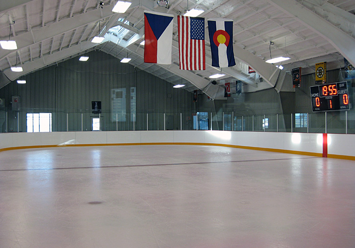 45' x 90' permanent rink with 3 RinkMate chillers, rink boards and protective netting