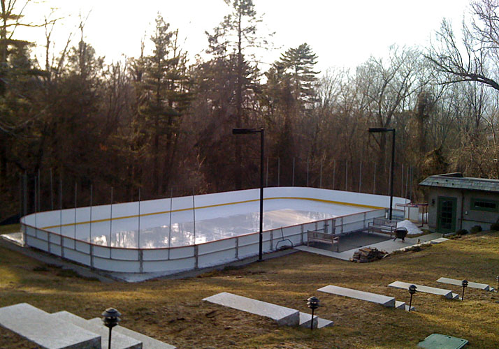 40' x 80' Permanent ice rink and sports pad with rink boards and protective netting