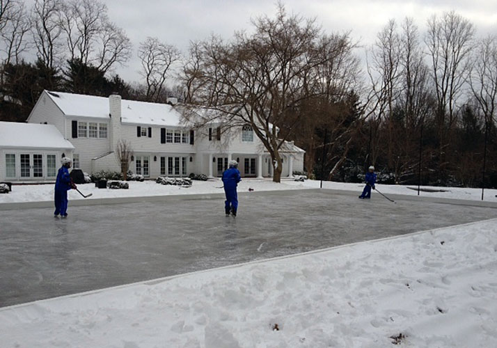 60' x 120' Permanent Indoor ice rink and sports pad.