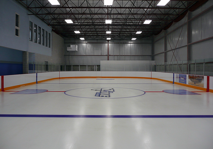 Indoor year round training rink with refrigeration, rink boards and glass.